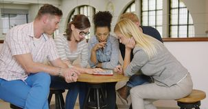 People around table searching for new ideas