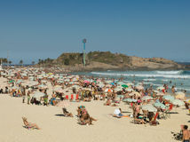 People on Arpoador Beach during the Summer- Rio de Janeiro Stock Photography