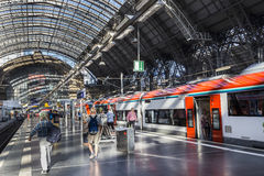 People arrive and depart at Frankfurt train station. FRANKFURT, GERMANY - AUG 30, 2016: people arrive and depart at Frankfurt train station. The classicistic Royalty Free Stock Photo