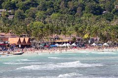 People arrived on the island of Koh Phangan, to participate in the New Year celebrations, Thailand. KOH PHANGAN,THAILAND - DECEMBER 31, 2014 : Haad Rin beach Royalty Free Stock Image