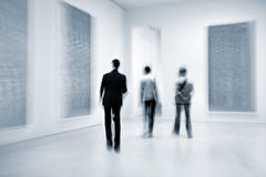 People in the art gallery center Stock Photography