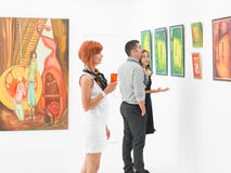 People in art gallery Stock Images