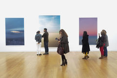People in art gallery stock image