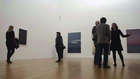 People in art gallery beholder onlooker stock video