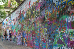 People and art at the Lennon Wall in Prague Stock Photo