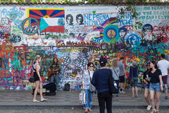 People and art at the Lennon Wall in Prague Stock Image