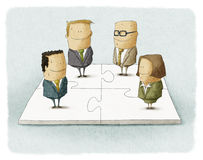 People as pieces of a business puzzle Stock Photos
