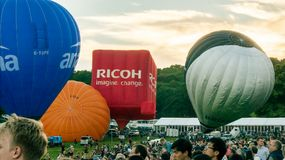 People in the ascent of Balloons Stock Photo