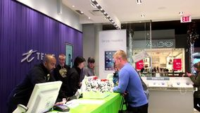 People asking telus sales clerk about cellphone plan