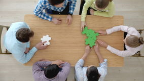 People assembling puzzle. Hipster business successful teamwork concept, business group assembling jigsaw puzzle