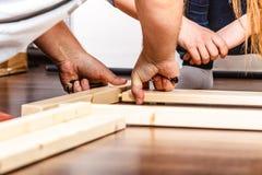 People assembling wood furniture. DIY. Royalty Free Stock Image