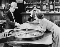 Free People At Roulette Table In Bar Stock Images - 52003914