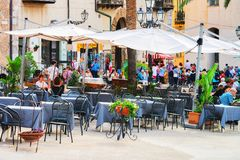Free People At Street Restaurants In Cefalu Old Town Sicily Royalty Free Stock Photo - 111851535
