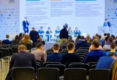 People attend business conference in congress hall Stock Photography