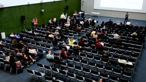 People attend Digital Marketing Conference in big hall stock footage
