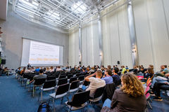 People attend Digital Marketing Conference in big hall Stock Photography
