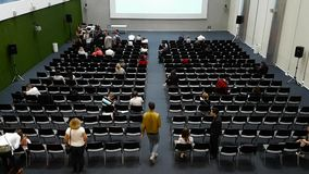 People attend Digital Marketing Conference in big hall stock video footage