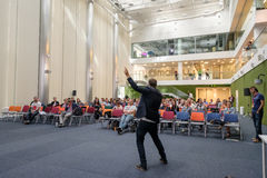 People attend Digital Marketing Conference in big hall Royalty Free Stock Image