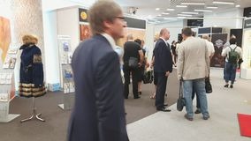 People attend exhibition at Amber Forum stock video