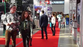 People attend international exhibition stock video