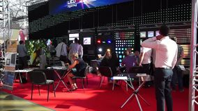 People attend international exhibition stock video footage