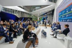 People attend Open Innovations 2017 forum. Skolokovo, Russia - October 16, 2017: People attend Open Innovations 2017 forum in new building Skolkovo Technopark Royalty Free Stock Image
