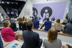 People attend Open Innovations 2017 forum. Skolokovo, Russia - October 16, 2017: People attend Open Innovations 2017 forum in new building Skolkovo Technopark Stock Photography