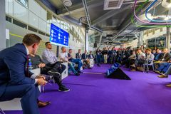 People attend Open Innovations 2017 forum. Skolokovo, Russia - October 16, 2017: People attend Open Innovations 2017 forum in new building Skolkovo Technopark Stock Photos