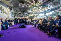 People attend Open Innovations 2017 forum. Skolokovo, Russia - October 16, 2017: People attend Open Innovations 2017 forum in new building Skolkovo Technopark Stock Image