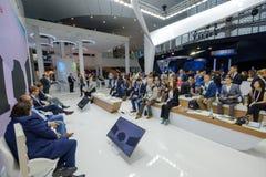 People attend Open Innovations 2017 forum. Skolokovo, Russia - October 16, 2017: People attend Open Innovations 2017 forum in new building Skolkovo Technopark Royalty Free Stock Images