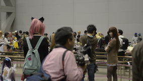 People attend Tokyo Dream Party, an Anime and Manga Cosplay convention stock video footage
