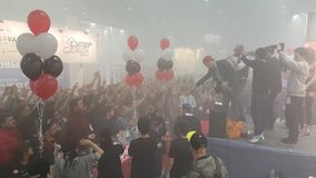 People attend Vapexpo Moscow 2016 exhibition. Moscow, Russia - December 9, 2016: Organizers throwing gifts to visitors at Vapexpo Moscow 2016 exhibition which stock video footage