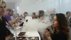 People attend Vapexpo Moscow 2016 exhibition stock video footage