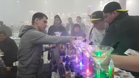 People attend Vapexpo Moscow 2016 exhibition. Moscow, Russia - December 9, 2016: People attend Vapexpo Moscow 2016 exhibition which presents new modern vape stock video
