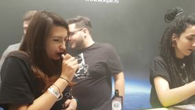 People attend Vapexpo Moscow 2016 exhibition. Moscow, Russia - December 9, 2016: People attend Vapexpo Moscow 2016 exhibition which presents new modern vape stock footage