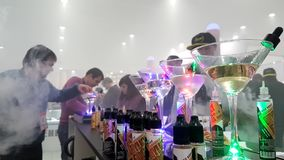 People attend Vapexpo Moscow 2016 exhibition. Moscow, Russia - December 9, 2016: People attend Vapexpo Moscow 2016 exhibition which presents new modern vape stock video footage