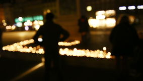 People attend a vigil and light candles in the center of French city stock footage