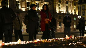People attend a vigil and light candles stock video footage