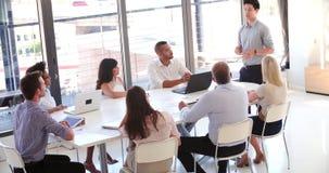 People Attending Business Meeting In Modern Open Plan Office stock video footage