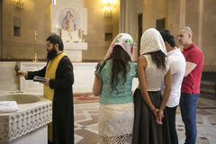 People attending mass in Armenian monastery comple. X of Moscow during the bapyism Stock Photo