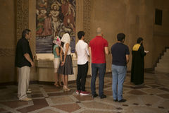 People attending mass in Armenian monastery complex of Moscow. During the bapyism Royalty Free Stock Photos