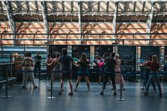 People attending a retro dance event inside St. Pancras Station, London, UK. royalty free stock photo