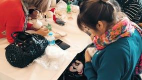 People attending a workshop and exhibition called Arzu'nun Bebekleri in Eskisehir. Eskisehir, Turkey - April 08, 2017: Women creating handmade art dolls in group stock video