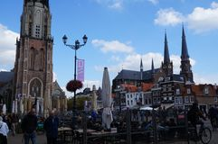 People attends the central square of Delft. Delft, Netherlands - September 30 2018: People attends the central square of the city stock image