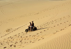 People on ATV in desert Stock Images
