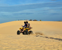 People on ATV in desert Royalty Free Stock Photos