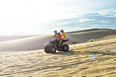 People on ATV in desert Stock Image