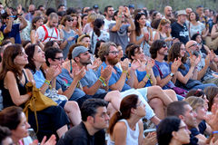 People from the audience watch a concert at Vida Festival Stock Photo