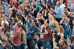 People from the audience watching a concert. BARCELONA - MAY 30: People from the audience watching a concert at Heineken Primavera Sound 2014 Festival (PS14) on stock image
