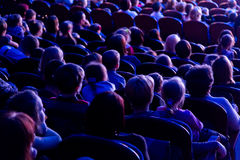 People in the auditorium looking at the stage. Shooting from the back Royalty Free Stock Images